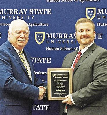 (left) Hutson School of Agriculture Dean Dr. Tony Brannon (right) Curtis Dame. Photo from Murray Ledger